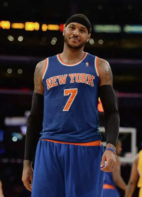 According to reports August 22, 2014, Carmelo Anthony has opted out of his contract with the New York Knicks and will become an unrestricted free agent. LOS ANGELES, CA - MARCH 25:  Carmelo Anthony #7 of the New York Knicks reacts to his delay of game warning during the game against the Los Angeles Lakers at Staples Center on March 25, 2014 in Los Angeles, California.   NOTE TO USER: User expressly acknowledges and agrees that, by downloading and or using this Photograph, user is consenting to the terms and condition of the Getty Images License Agreement.  (Photo by Harry How/Getty Images) Photo: Harry How, Staff / 2014 Getty Images