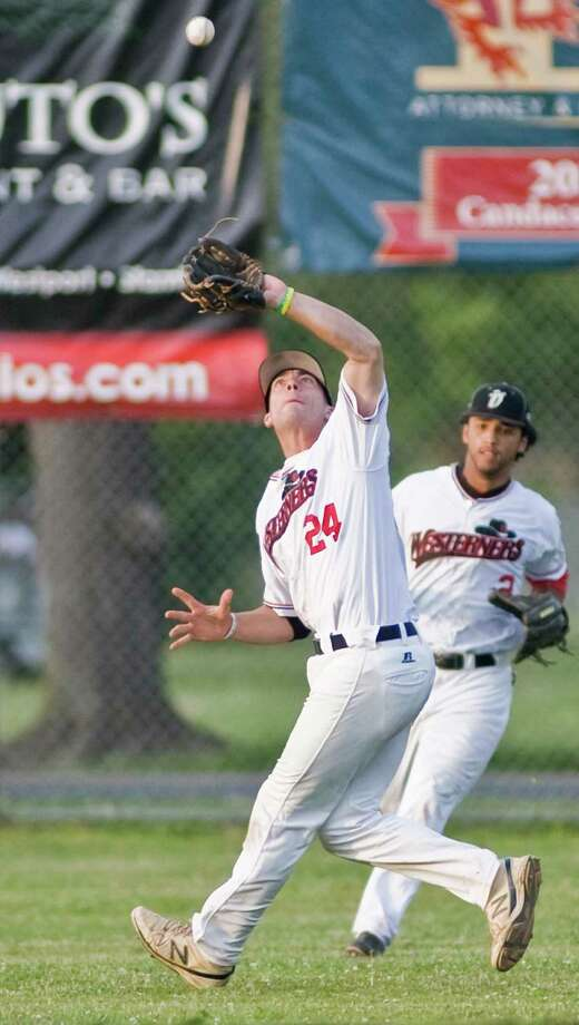 Danbury Westerners Joe Poduslenko makes the out on a Newport Gulls fly ball in a game played at Rogers Park in Danbury. June 28, 2014 Photo: Scott Mullin / The News-Times Freelance