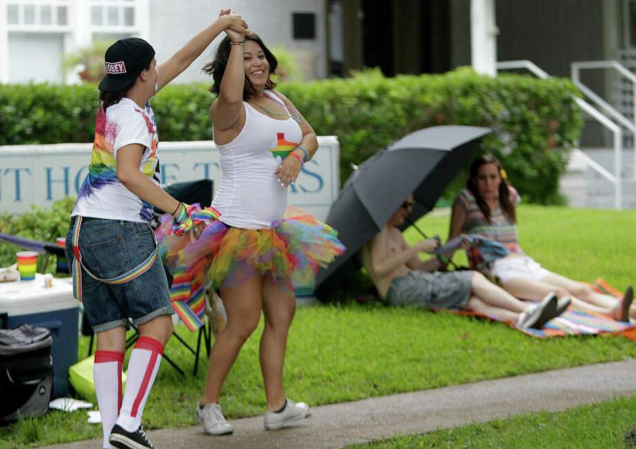 HoustonAmanda Gallardo, right, dances with her sweetheart during the Houston Pride Festival on Saturday. Photo: Mayra Beltran, Staff / © 2014 Houston Chronicle