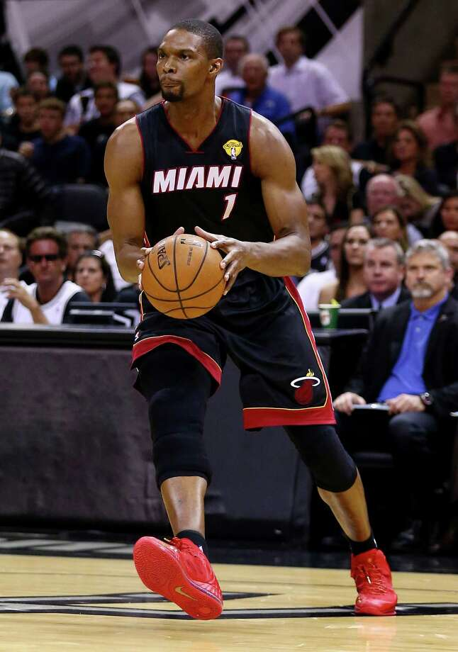FILE - JUNE 28, 2014: It was reported that both Dwyane Wade and Chris Bosh are opting out of their contracts with the Miami Heat in order to be free agents June 28, 2014. SAN ANTONIO, TX - JUNE 15:  Chris Bosh #1 of the Miami Heat drives to the basket against the San Antonio Spurs during Game Five of the 2014 NBA Finals at the AT&T Center on June 15, 2014 in San Antonio, Texas. NOTE TO USER: User expressly acknowledges and agrees that, by downloading and or using this photograph, User is consenting to the terms and conditions of the Getty Images License Agreement.  (Photo by Andy Lyons/Getty Images) ORG XMIT: 495643449 Photo: Andy Lyons / 2014 Getty Images