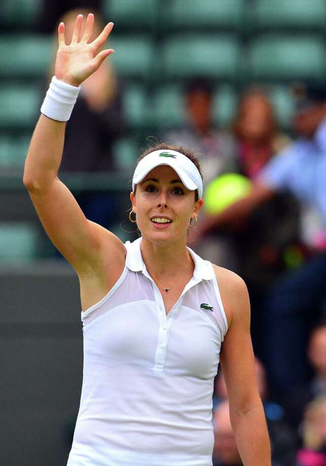 France's Alize Cornet celebrates after winning her women's singles third round match against US player Serena Williams on day six of the 2014 Wimbledon Championships at The All England Tennis Club in Wimbledon, southwest London, on June 28, 2014. AFP PHOTO / CARL COURT  - RESTRICTED TO EDITORIAL USECARL COURT/AFP/Getty Images Photo: CARL COURT, Stringer / AFP
