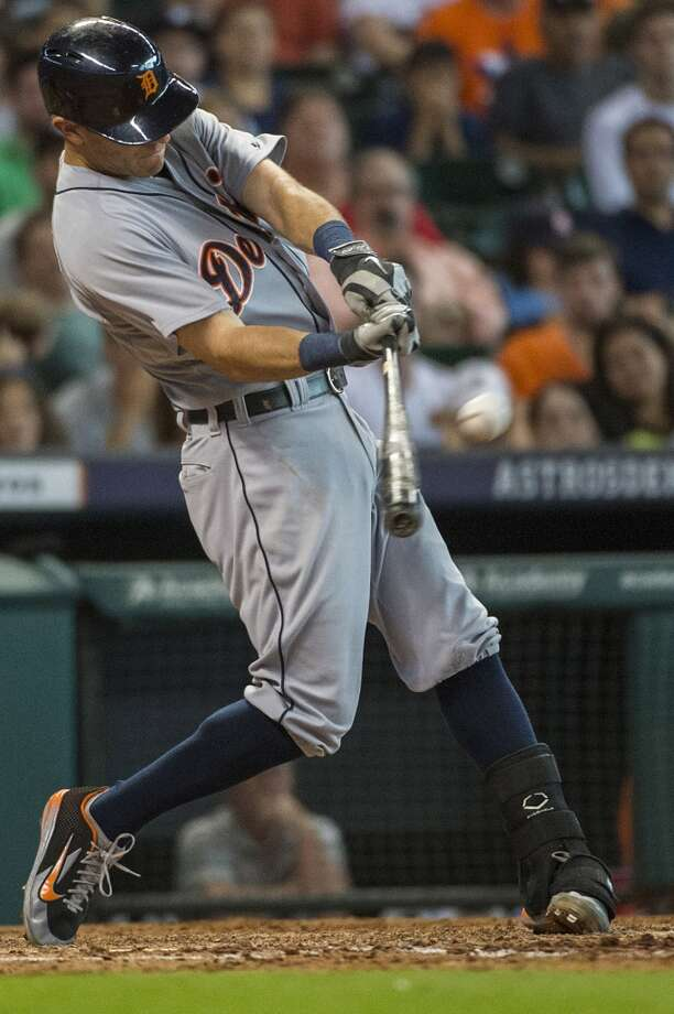 Tigers second baseman Ian Kinsler connects on a 3-run home run during the ninth inning. Photo: Smiley N. Pool, Houston Chronicle