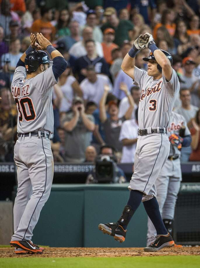 Tigers second baseman Ian Kinsler celebrates with Eugenio Suarez after hitting a 3-run home run during the ninth inning. Photo: Smiley N. Pool, Houston Chronicle