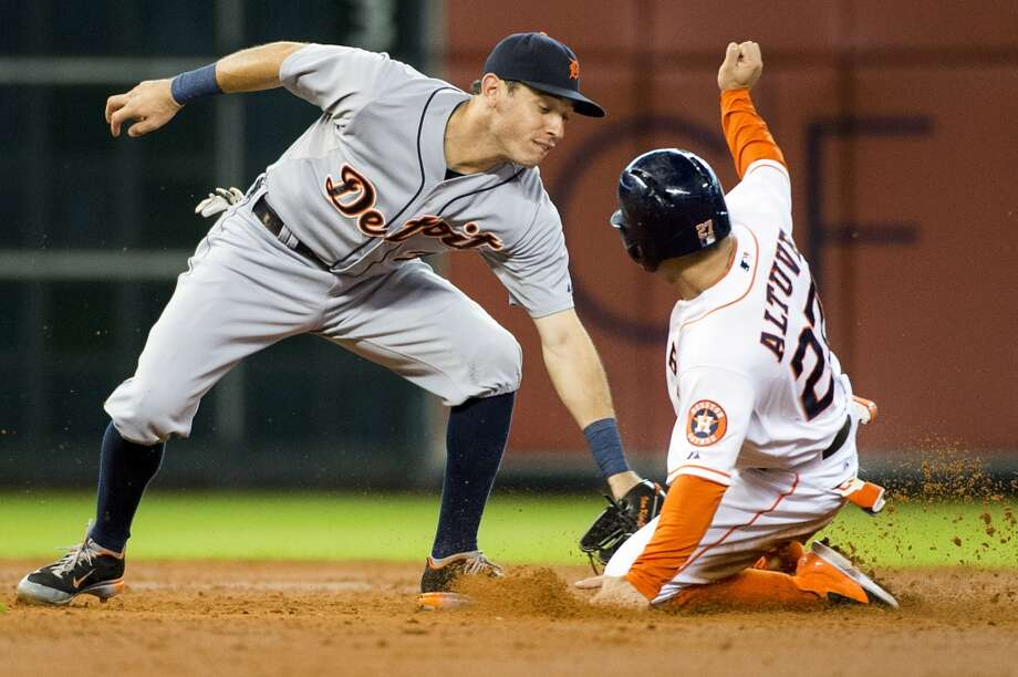 Jose Altuve gets past the tag from Tigers second baseman Ian Kinsler during the third inning for his 33rd stolen base of the season. Photo: Smiley N. Pool, Houston Chronicle