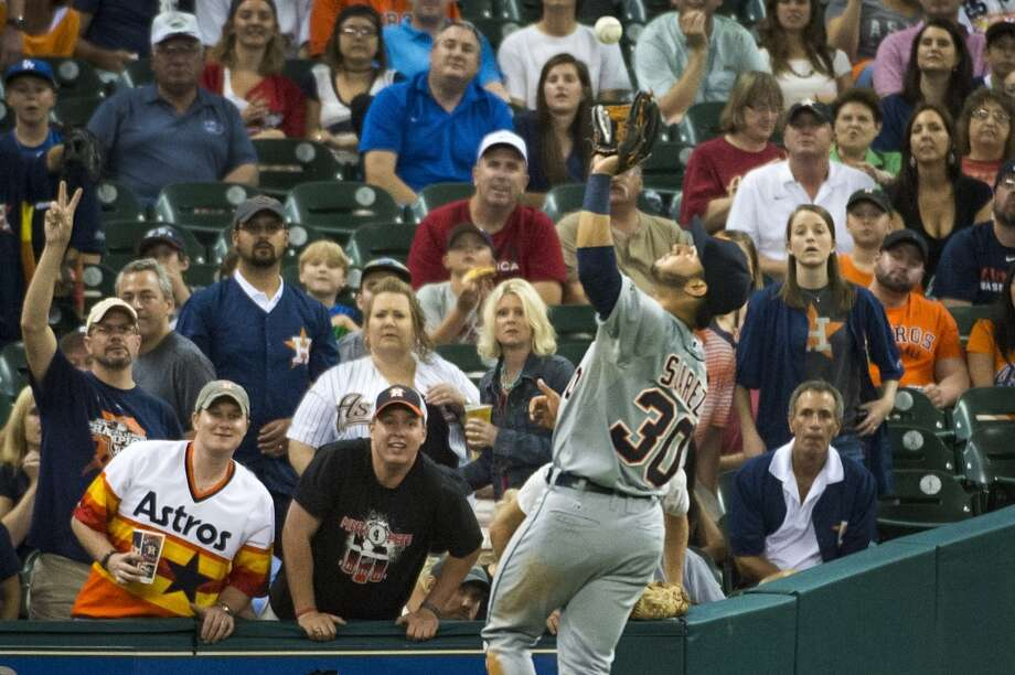 Tigers shortstop Eugenio Suarez goes into foul territory to grab a popup off the bat of the Astros' Marwin Gonzalez during the second inning. Photo: Smiley N. Pool, Houston Chronicle