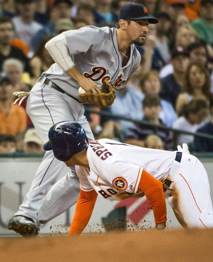 Houston Astros right fielder George Springer is safe at third base as the ball slips out of the glove of Detroit Tigers third baseman Nick Castellanos during the first inning. Photo: Smiley N. Pool, Houston Chronicle