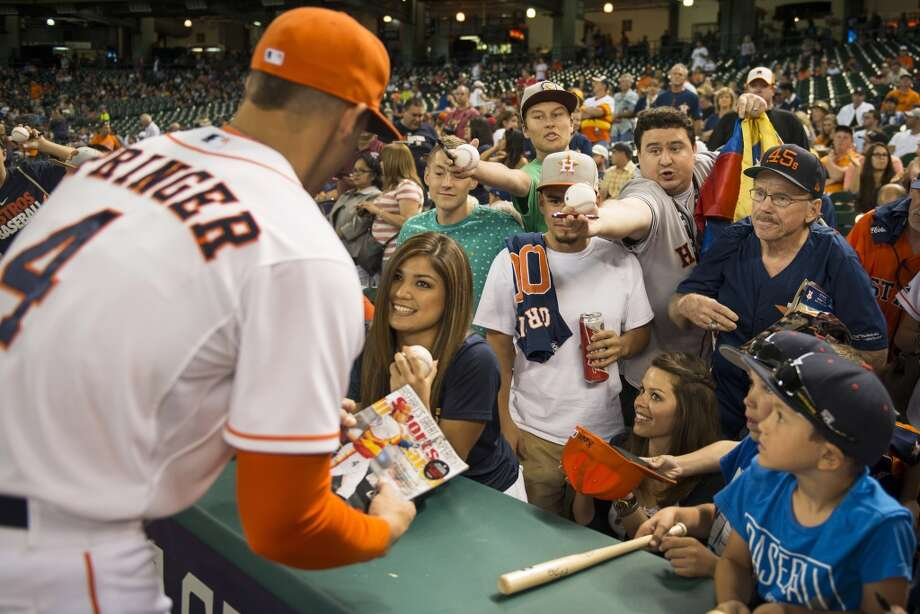 Astros right fielder George Springer signs autographs before the game. Photo: Smiley N. Pool, Houston Chronicle