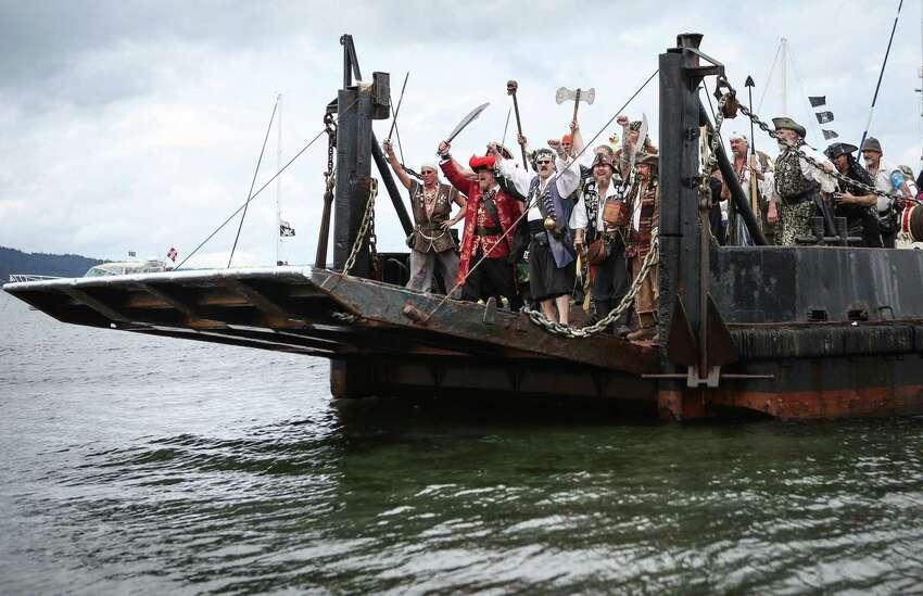 The Seafair Pirates landing craft approaches Alki Beach.