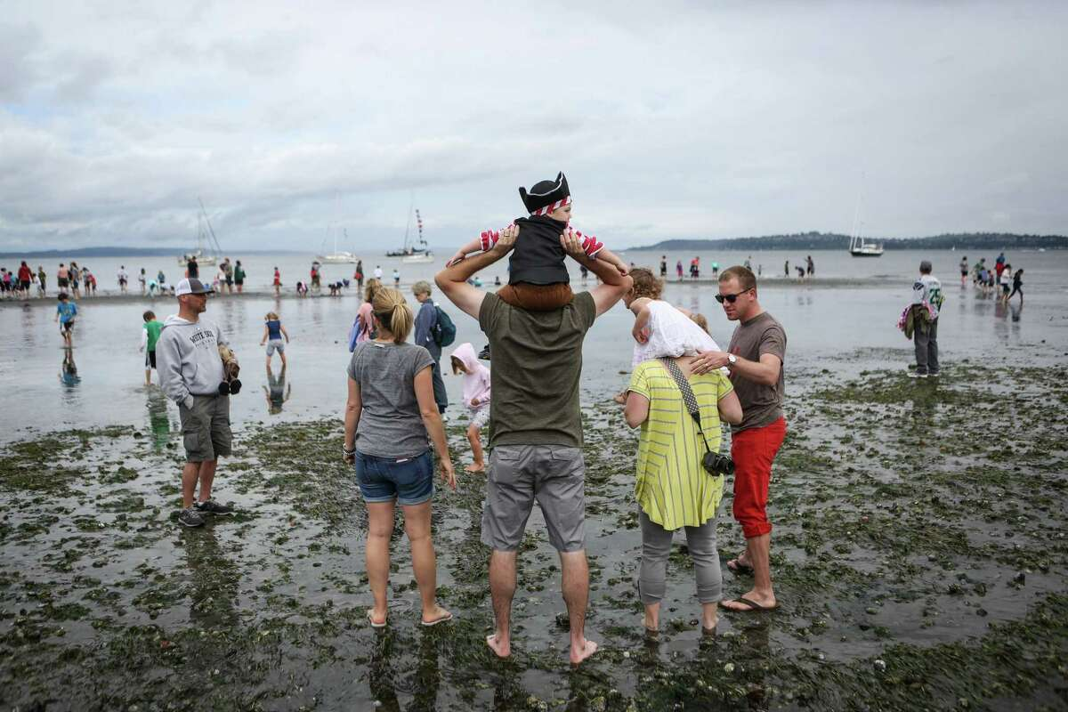 Spectators wait for the Seafair Pirates to land on Alki Beach.