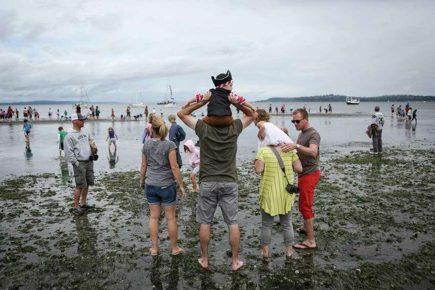 Spectators wait for the Seafair Pirates to land on Alki Beach.