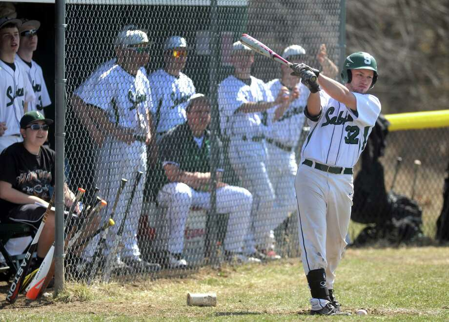 Schalmont outfielder Greg Musk, right, warms up during their boy's high school baseball game against Cairo-Durham on Saturday April 12, 2014 in Rotterdam, N.Y. (Michael P. Farrell/Times Union) Photo: Michael P. Farrell / 00026472A