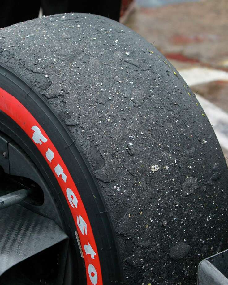 A front tire on the car of IndyCar driver Carlos Huertas shown after he won the IndyCar Series Race #1 at the Grand Prix of Houston at NRG Park Saturday, June 28, 2014, in Houston. Photo: Melissa Phillip, Houston Chronicle / © 2014  Houston Chronicle