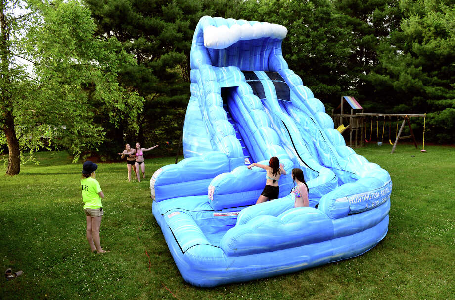 The Rodriguez family rented this inflatable waterslide from local business Huntington Rental for a summer party at their house in Shelton, Conn. on Saturday June 28, 2014. Photo: Christian Abraham / Connecticut Post