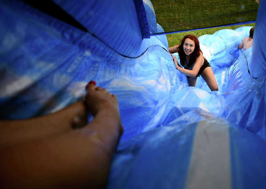 Amanda Rodriguez, 15, tries to climb up the slide in an inflatable waterslide, during a summer party at her house in Shelton, Conn. on Saturday June 28, 2014. The slide is rented out to the the Rodriguez family by local business Huntington Rental. Photo: Christian Abraham / Connecticut Post