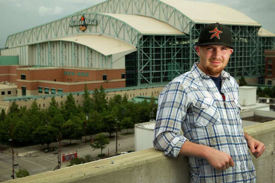 Daren Willman, who runs a hardcore baseball analysis website, works within shouting distance of Minute Maid Park. Photo: Brett Coomer, Staff / © 2014 Houston Chronicle