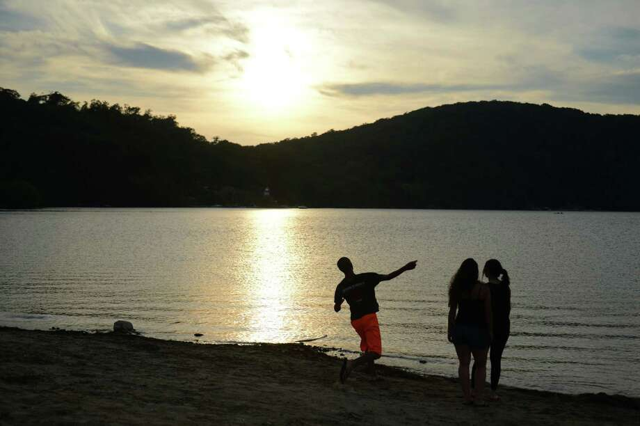 Kids throw stones into Candlewood Lake before the Independence Day fireworks display at Candlewood Town Park in Danbury, Conn. Saturday, June 28, 2014. Photo: Tyler Sizemore / The News-Times
