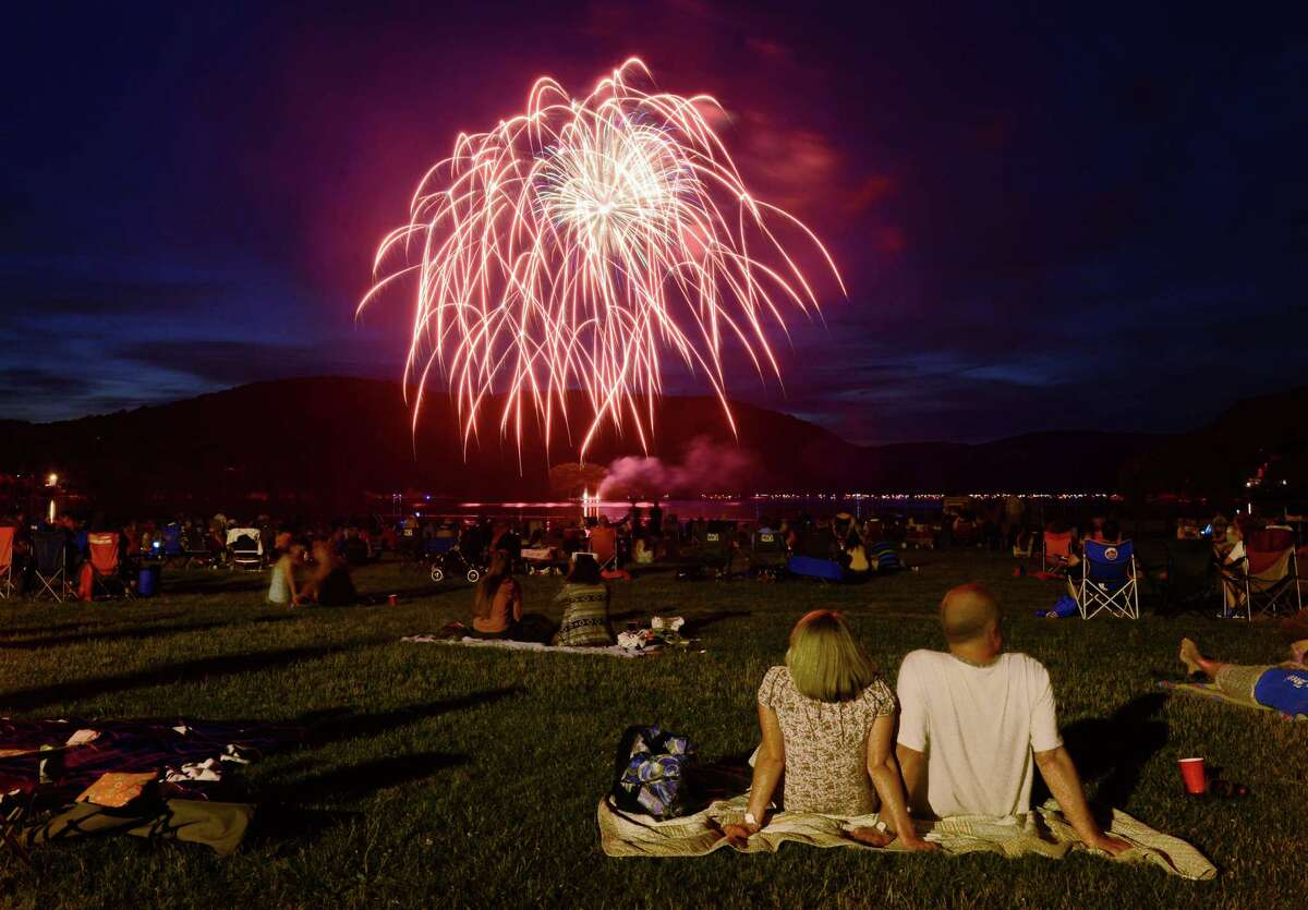 Spectators watch the Independence Day fireworks display at Candlewood Town Park on Candlewood Lake in Danbury, Conn. Saturday, June 28, 2014.