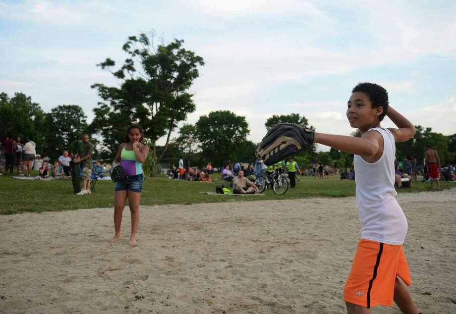 Kids throw a basseball before the Independence Day fireworks display at Candlewood Town Park on Candlewood Lake in Danbury, Conn. Saturday, June 28, 2014. Photo: Tyler Sizemore / The News-Times
