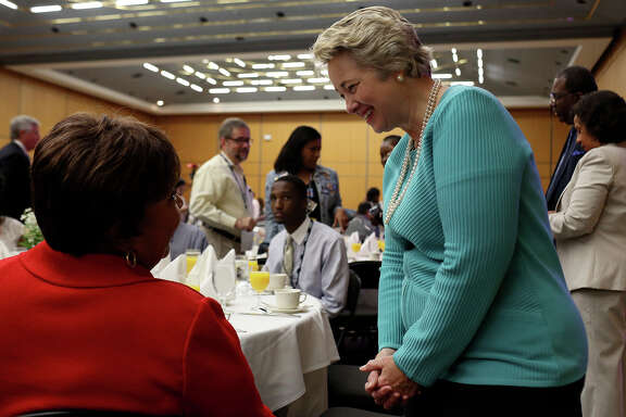 Houston Mayor Annise Parker, right, talks with Congresswoman Eddie Bernice Johnson, of Dallas, during the Lady Bird Johnson Breakfast at the Texas Democratic State Convention at the Dallas Convention Center in Dallas on Saturday, June 28, 2014.