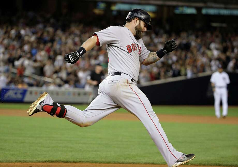 Boston Red Sox's Mike Napoli rounds first base after hitting a solo home run over against the New York Yankees in the ninth inning of a baseball game, Saturday, June 28, 2014, in New York. The Red Sox won 2-1. (AP Photo/Julie Jacobson)  ORG XMIT: NYY109 Photo: Julie Jacobson / AP