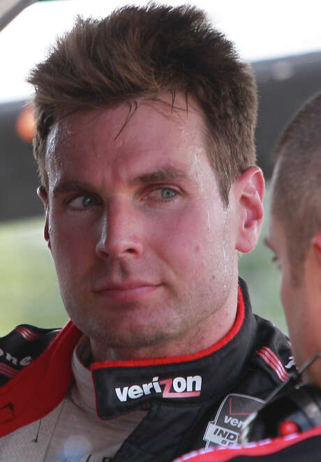 IndyCar driver Will Power talks with a crew member during an IndyCar qualifying session for the Grand Prix of Houston at NRG Park Saturday, June 28, 2014, in Houston. ( Melissa Phillip / Houston Chronicle ) Photo: Melissa Phillip, Staff / © 2014  Houston Chronicle