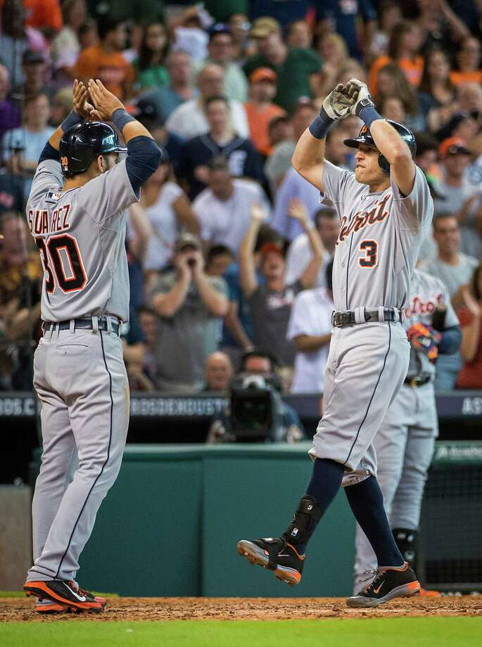 For the Tigers and Ian Kinsler (3), it was party time after his three-run homer in the ninth inning Saturday. But for Astros reliever Jerome Williams, right, it was anything but happy hour after he couldn't protect a one-run lead at the end. Photo: Smiley N. Pool / © 2014  Smiley N. Pool