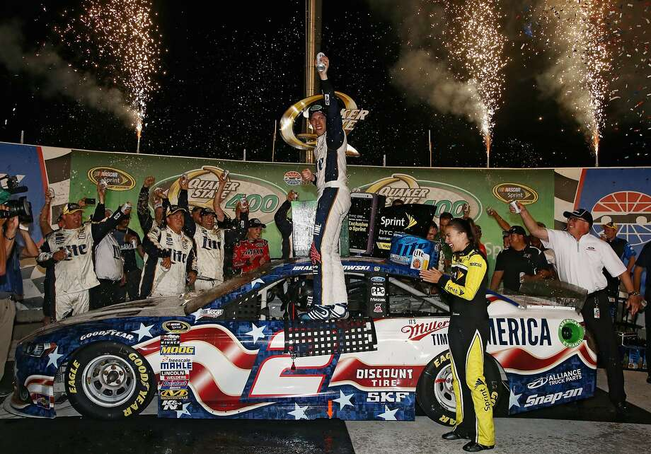 Brad Keselowski is on top of the celebration, but later cut his hand on a broken Champagne bottle and needed medical attention. Photo: Sean Gardner, Getty Images