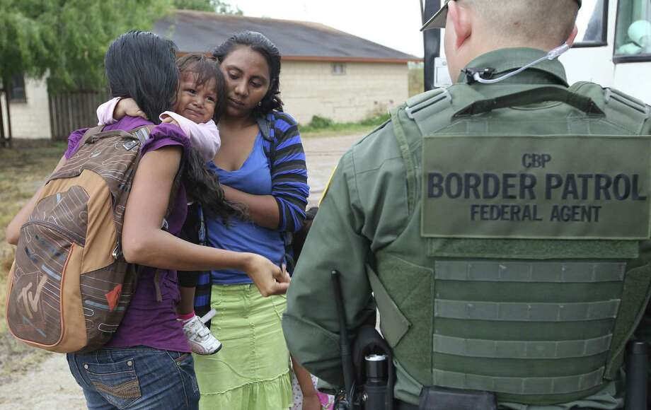 JUNE 25, 2014, 5:05 PM, GRANJENO, TEXAS Ï An infant cries as U.S. Border Patrol agents process a group of immigrants in Granjeno, Texas. The city is just north of  ÓEl Rincon del Diablo,Ô the DevilØs Corner, a hotbed of illegal border crossing on the Rio Grande by juvenile and mothers with children immigrants from Central America. Photo: Jerry Lara, San Antonio Express-News / ©2014 San Antonio Express-News