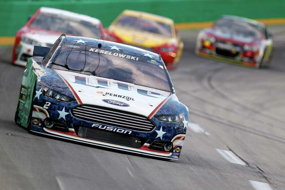SPARTA, KY - JUNE 28:  Brad Keselowski, driver of the #2 Miller Lite Ford, leads a pack of cars during the NASCAR Sprint Cup Series Quaker State 400 presented by Advance Auto Parts at Kentucky Speedway on June 28, 2014 in Sparta, Kentucky.  (Photo by Gregory Shamus/Getty Images) ORG XMIT: 463775137 Photo: Gregory Shamus / 2014 Getty Images