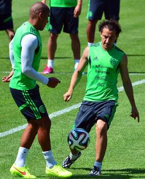 Carlos Salcido (left), practicing with teammate Andres Guardado, will replace suspended Jose Juan Vazquez for Mexico's showdown against the Netherlands today. Photo: Yuri Cortez / Getty Images / YURI CORTEZ