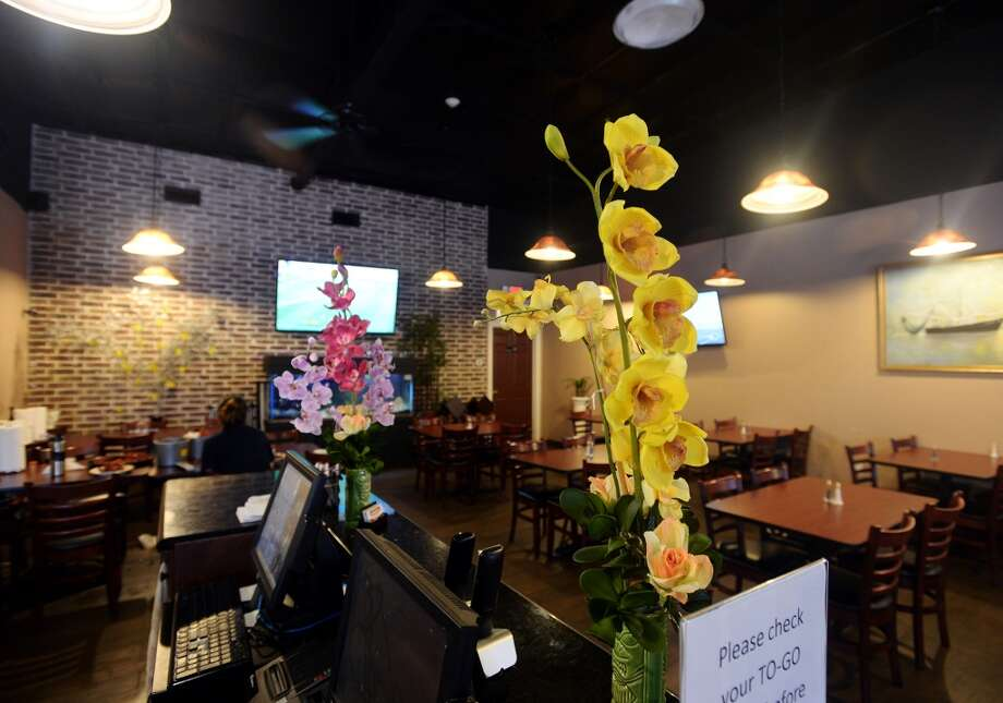 Flowers decorate the bar area of Kevin Rico Seafood and Oyster Bar in Port Arthur on Tuesday. The establishment is the Cat5 Restaurant of the Week for June 26, 2014. Photo taken Tuesday 6/17/14 Jake Daniels/@JakeD_in_SETX