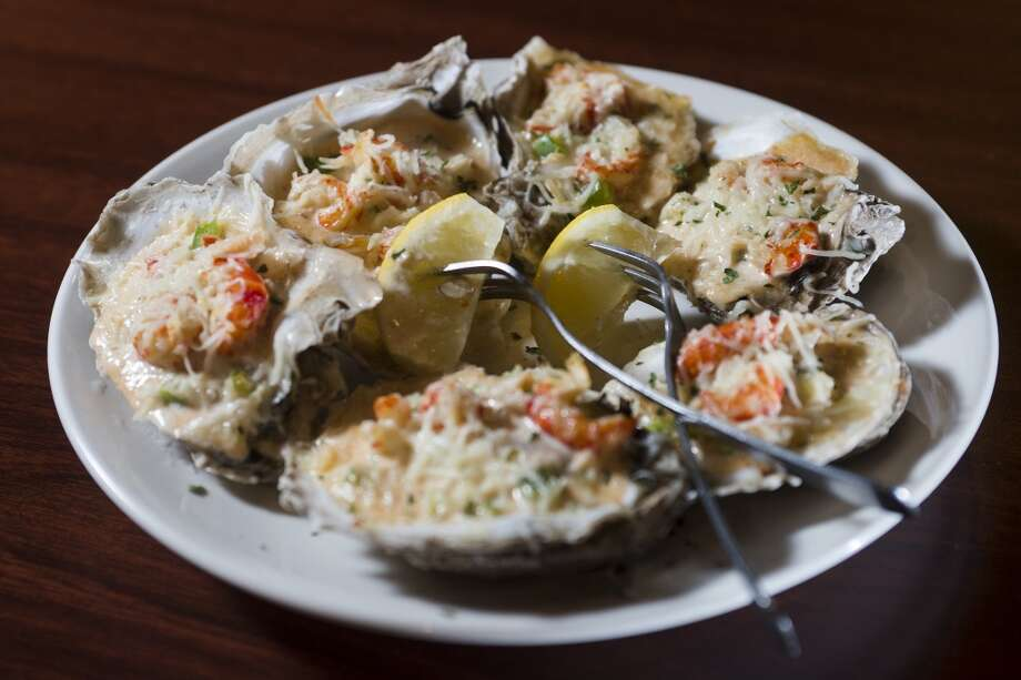 Pictured is the Anna's Oysters dish from Kevin Rico Seafood. The dish is six baked oysters with chopped bell peppers and onion, and topped with bacon crumbles. Kevin Rico Seafood and Oyster Bar in Port Arthur is the Cat5 Restaurant of the Week for June 26, 2014. Photo taken Tuesday 6/17/14 Jake Daniels/@JakeD_in_SETX