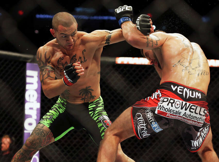 Cub Swanson tries to get under Jeremy Stephens as they battle in the main event during the UFC Fight Night at the AT&T Center on June 28, 2014.