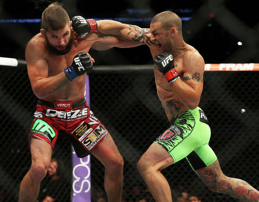 Jeremy Stephens (left) and Cub Swanson battle in the main event during the UFC Fight Night at the AT&T Center on June 28, 2014.