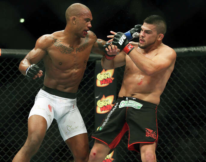 Nico Musoke (left) fights Kelvin Gastelum during UFC Fight Night at the AT&T Center on June 28, 2014