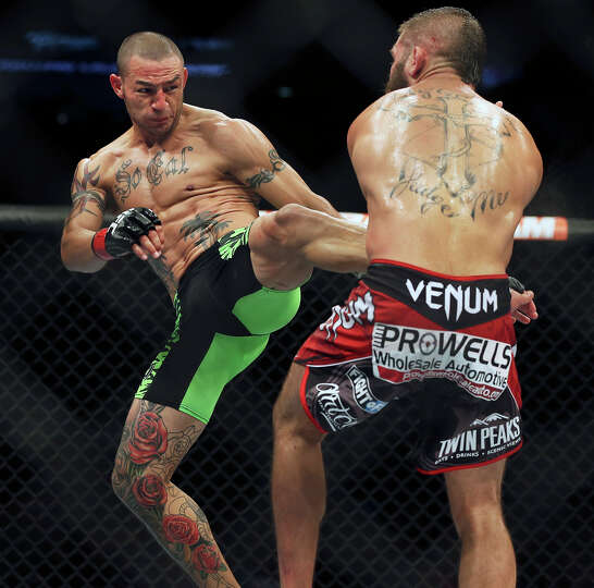 Cub Swanson swings in a kick against Jeremy Stephens as they battle in the main event during the UFC