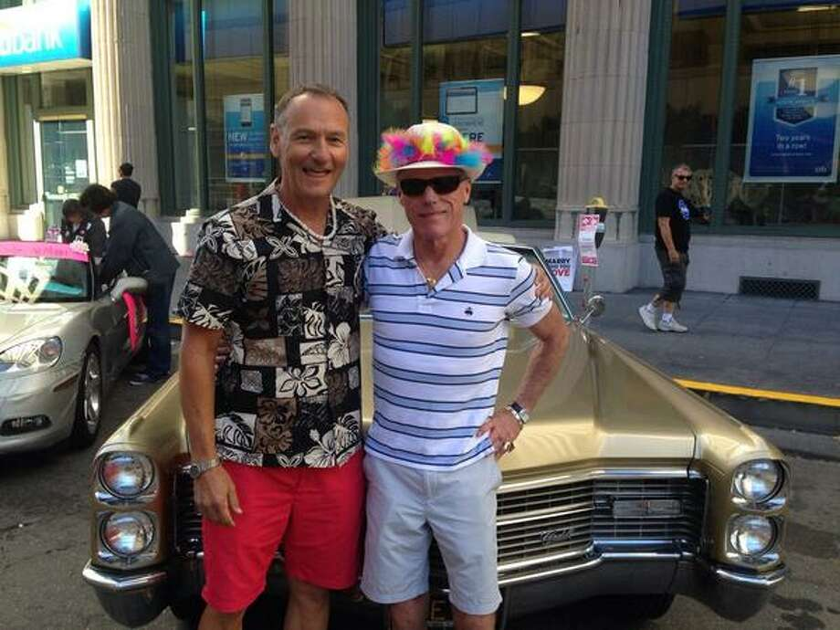 "John and Steve, together since '90, married since '08. ""The parade's ""evolved -- it's a family event now."" Photo: The Chronicle"