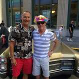 """John and Steve, together since '90, married since '08. """"The parade's """"evolved -- it's a family event now."""""""