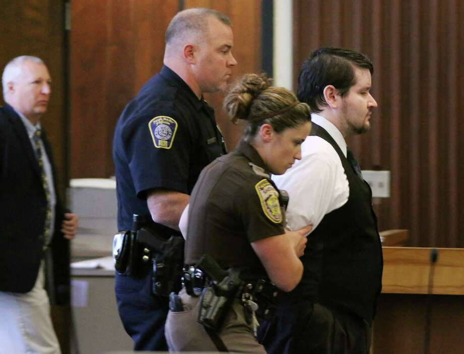 "Defendent Seth Mazzaglia, right, is lead from the courtroom Friday, June 27, 2014 in Strafford County Superior Court in Dover, N.H. after he was found guilty of murder for the the Oct. 9, 2012 strangulation death of 19-year-old Elizabeth ""Lizzi"" Marriott, who was a student at the University of New Hampshire. He will be sentenced to life in prison without the chance of parole. Photo: Rich Beauchesne, AP  / c. Rich Beauchesne 2014"