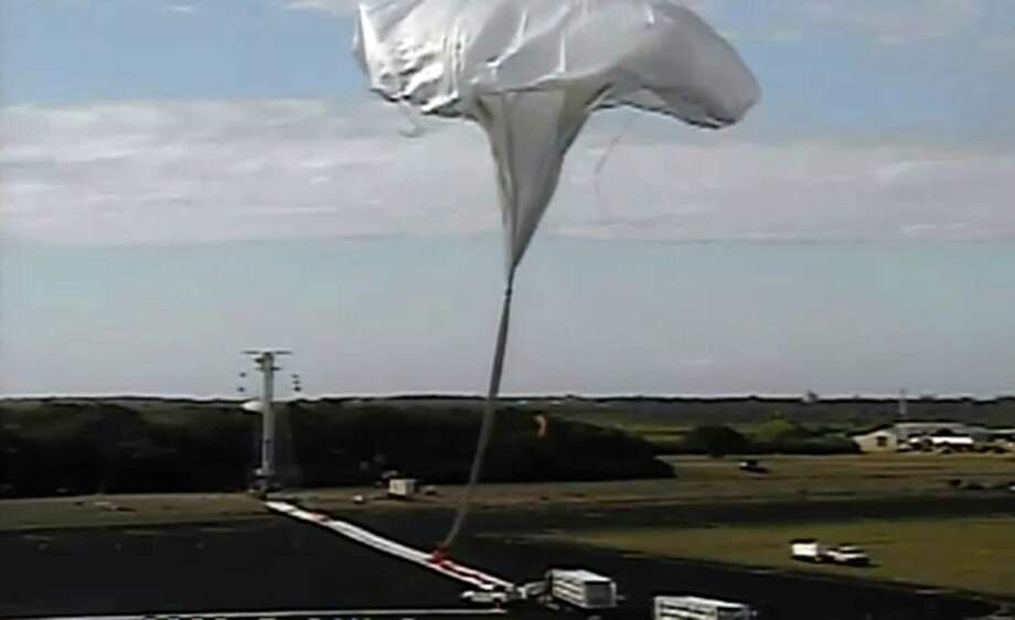 This image taken from video provided by NASA shows the launch of the high-altitude balloon carrying a saucer-shaped vehicle for NASA, to test technology that could be used to land on Mars, Saturday June 28, 2014 in Kauai, Hawaii. Saturday's experimental flight high in Earth's atmosphere is testing a giant parachute designed to deliver heavier spacecraft and eventually astronauts. Photo: Uncredited, AP  / AP2014
