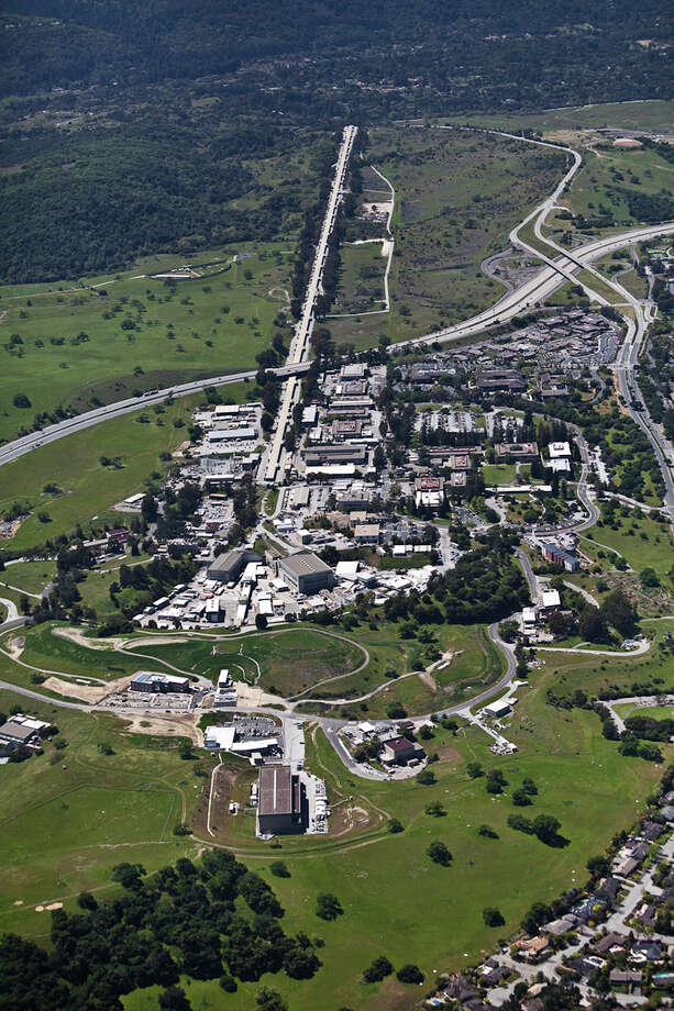 This undated image provided by the SLAC National Accelerator Laboratory shows an aerial view of the SLAC site, looking west. Authorities say a smoky fire at the Stanford Linear Accelerator late Wednesday evening June 25, 2014 forced the closure of the nearby interstate, but the blaze didn't cause any injuries or pose a threat to the public. Photo: Brad Plummer, AP  / SLAC National Accelerator Laboratory