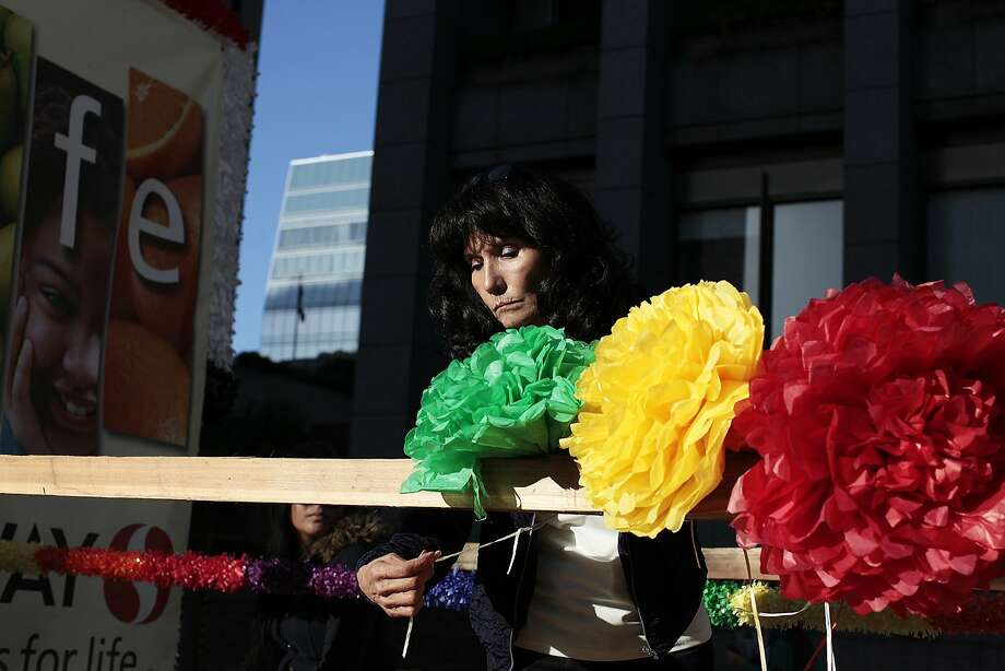Maria Schabbing puts flowers on the Safeway float before the Pride Parade in San Francisco, Calif. on Sunday, June 29, 2014. The annual Pride Parade featured appearances from LGBT groups as well as local companies. Photo: James Tensuan, The Chronicle