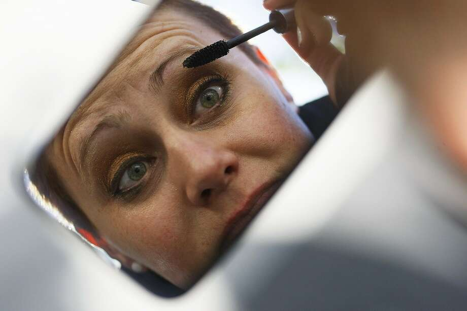 Miss Bee applies makeup before riding in the Pride Parade with the Dykes on Bikes in San Francisco, Calif. on Sunday, June 29, 2014. The annual Pride Parade featured appearances from LGBT groups as well as local companies. Photo: James Tensuan, The Chronicle