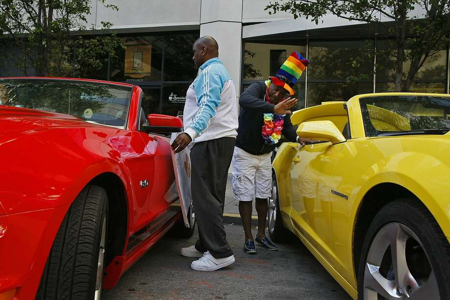 Darrel Kelly, left, and Julius Crane of Glide Memorial decorate their Mustangs before the Pride Parade in San Francisco, Calif. on Sunday, June 29, 2014. The annual Pride Parade featured appearances from LGBT groups as well as local companies. Photo: James Tensuan, The Chronicle