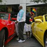 Darrel Kelly, left, and Julius Crane of Glide Memorial decorate their Mustangs before the Pride Parade in San Francisco, Calif. on Sunday, June 29, 2014. The annual Pride Parade featured appearances from LGBT groups as well as local companies.
