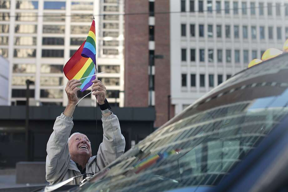 Emory Adamson puts a rainbow flag on the Safeway float before the Pride Parade in San Francisco, Calif. on Sunday, June 29, 2014. The annual Pride Parade featured appearances from LGBT groups as well as local companies. Photo: James Tensuan, The Chronicle