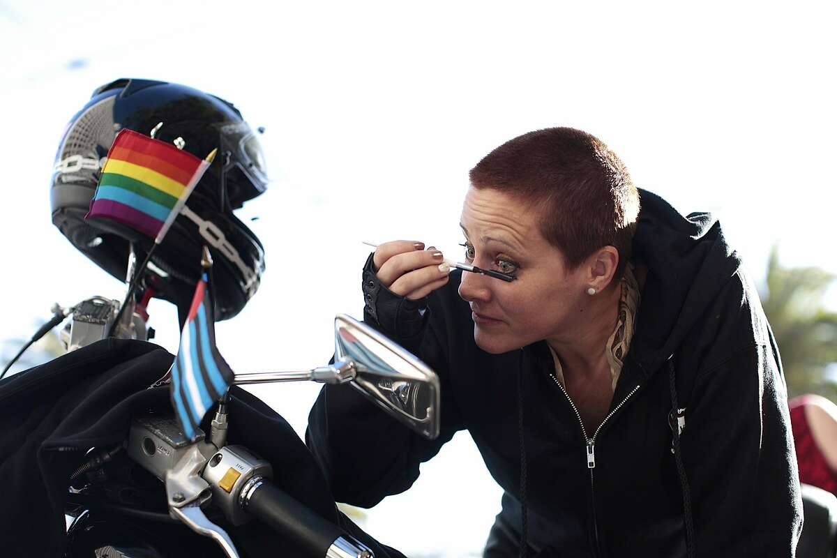 Miss Bee applies makeup before riding in the Pride Parade with the Dykes on Bikes in San Francisco on Sunday, June 29, 2014. The annual S.F. Pride parade featured appearances from LGBT groups as well as local companies.