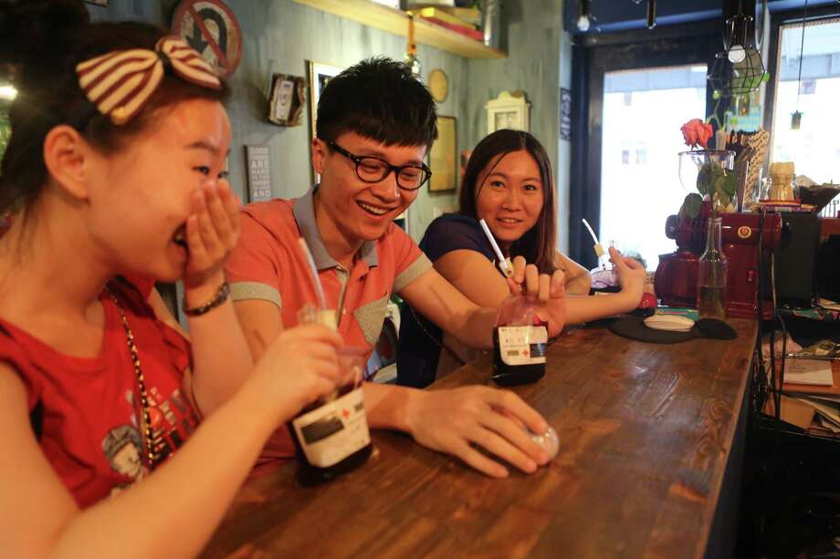 "People drink the ""Blood Bag"", a crimson beverage offered with two flavors of blueberry and cranberry on June 26, 2014 in Benxi, Liaoning province of China. ""Blood Bag"", a crimson beverage was marked by the sign of ""Blood Type Energy Supply"" as well as the symbol of Red Cross and the drink retails with the price of 30 RMB (about 4.8 USD) in China's northeast city of Benxi. (Photo by ChinaFotoPress via Getty Images) Photo: ChinaFotoPress, Getty Images  / 2014 ChinaFotoPress"