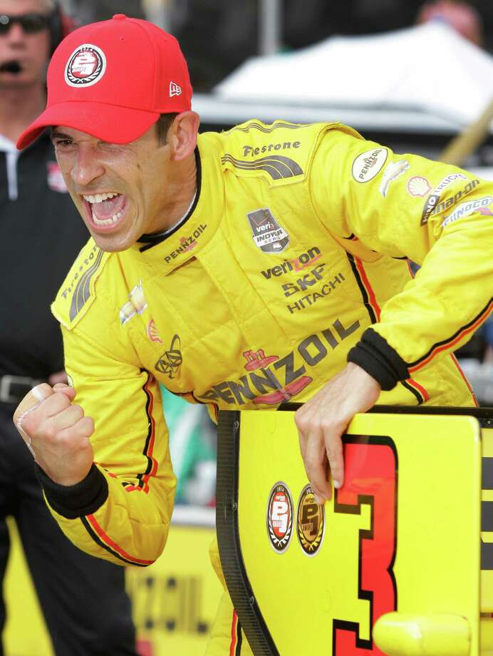 IndyCar driver Helio Castroneves  celebrates after winning the pole position for the IndyCar Series Race #2 at the Grand Prix of Houston at NRG Park Sunday, June 29, 2014, in Houston. Photo: Melissa Phillip, Houston Chronicle / © 2014  Houston Chronicle