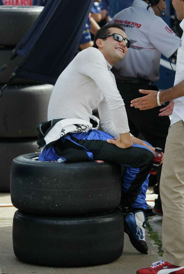 IndyCar driver Carlos Huertas sits on a stack of tires in his pit before a qualifying session for the IndyCar Series Race #2 at the Grand Prix of Houston at NRG Park Sunday, June 29, 2014, in Houston. Photo: Melissa Phillip, Houston Chronicle / © 2014  Houston Chronicle